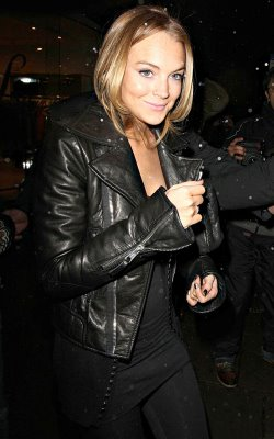 Lindsay Lohan in black leather jacket in London shopping